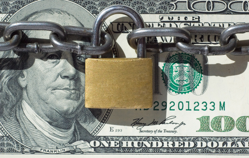 Financial security concept image one hundred dollars locked  with padlock