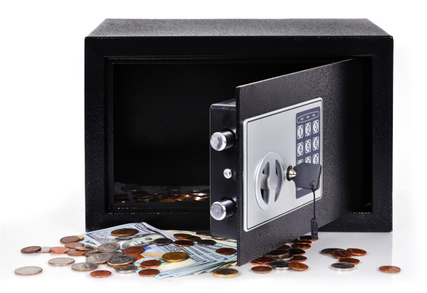 open safe with dollars and cent isolated on white